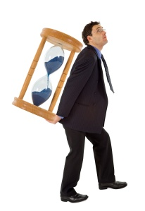 Businessman carrying a hourglass - isolated